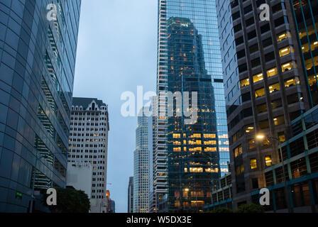 Los Angeles California USA. June 1st, 2019. Skyscrapers illuminated, blue sky background, spring evening - Stock Photo