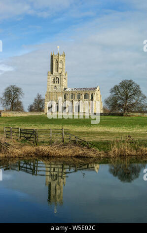 The historic church of St Mary and All Saints viewed from across the River Nene in the village of Fotheringhay, Northamptonshire, UK - Stock Photo