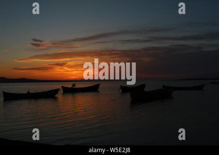Claudy Sunset and boats - Stock Photo