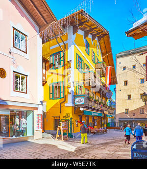 ZELL AM SEE, AUSTRIA - FEBRUARY 28, 2019: The narrow streets of old town are lined with scenic historical mansions, hotels, tourist restaurants and so - Stock Photo