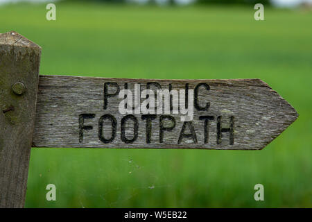 Old wooden public footpath sign - Stock Photo