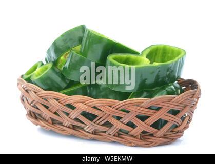 sliced poblano pepper on bamboo basket on white background - Stock Photo