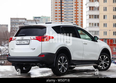 Novosibirsk, Russia - 07.25.2019: Rear view of Toyota RAV4 2015 year in white color after cleaning before sale on parking. Auto service industry. - Stock Photo