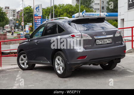 Novosibirsk, Russia - 07.25.2019: Gray Lexus RX350 2011 release with an engine of 3.5 liters rear view on the car parking after preparing for sale - Stock Photo