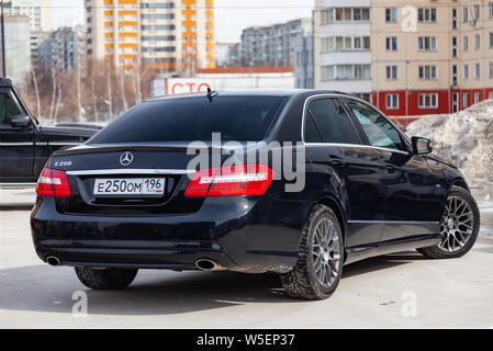 Novosibirsk, Russia - 07.25.2019: Black Mercedes Benz E-class E250 2010 year rear view with dark gray interior in excellent condition in a parking spa - Stock Photo