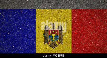 National flag of Moldavia on a stone background.The concept of national pride and symbol of the country. - Stock Photo