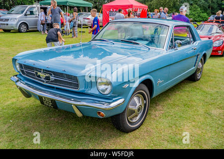 Side view of a blue vintage Ford Mustang on display at the annual classic car show in Wroxham, Norfolk, UK - Stock Photo
