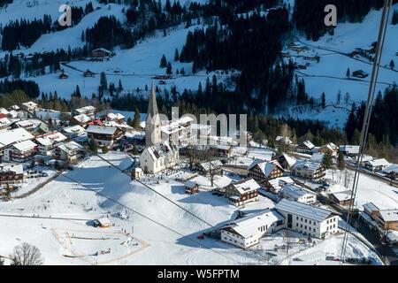 Austria, Kleinwalsertal (little Walser valley), Allgau Alps, cable car (way down) - Walmendinger Horn (1990 m), Mittelberg alpine village, parish church St. Jodok - Stock Photo