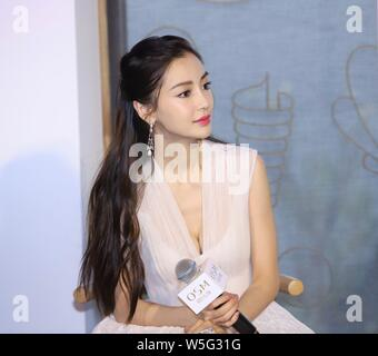 Hong Kong actress Angelababy attends a promotional event for OSM in Shanghai, China, 19 March 2019. - Stock Photo