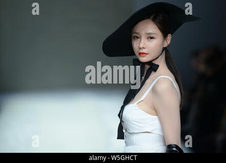 Chinese actress, host and model Shen Mengchen displays a new creation at the fashion show of GENIAL by Zhang Jinhao during the China Fashion Week Fall - Stock Photo
