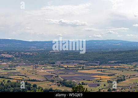 Vaucluse mountains : Background with aerial view on lavender fields surrounding the hilltop villages of Sault, Ferrassieres and Aurel - Stock Photo