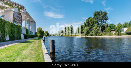 panoramic view of Spree river near Federal Chancellery in Berlin, Germany on sunny day in summer - Stock Photo