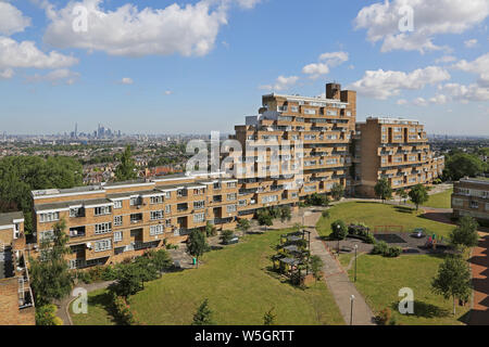 High level view of Dawson's Heights, the famous 1960s public housing project in South London, designed by Kate Macintosh. London skyline beyond. - Stock Photo