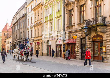 A horse drawn carriage in the medieval old town, UNESCO World Heritage Site, Krakow, Poland, Europe - Stock Photo