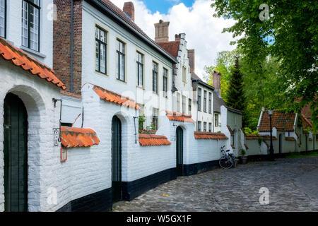 Begijnhof (Beguinage) houses, Order of St. Benedict Convent, UNESCO World Heritage Site, Bruges, Belgium, Europe - Stock Photo