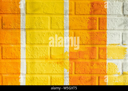 Bricks surface of wall, painted striped in bright orange and yellow colors. Graphic texture of colorful wall, for background - Stock Photo
