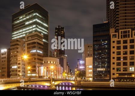 High rise office buildings in the Dotonbori area of Osaka at night, Osaka, Japan, Asia - Stock Photo