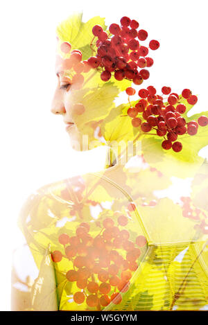 Double exposure portrait of bright green leaves and red fruits combined with a peaceful woman's face - Stock Photo