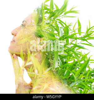Double exposure close up portrait combined with bright green leaves - Stock Photo