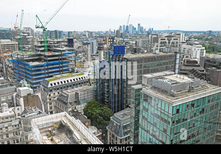 View of office buildings east towards Canary Wharf over cityscape from garden terrace at 120 Fenchurch Street City of London England UK  KATHY DEWITT - Stock Photo