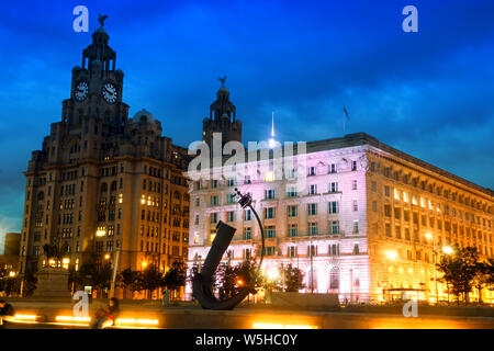 Liverpool's historic waterfront buildings at dusk - Stock Photo