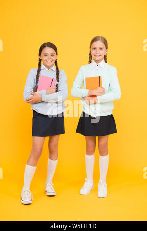 Secondary school. Schoolgirls tidy appearance school uniform. School friendship. Knowledge day. School day fun cheerful moments. Kids cute students. Schoolgirls best friends excellent pupils. - Stock Photo