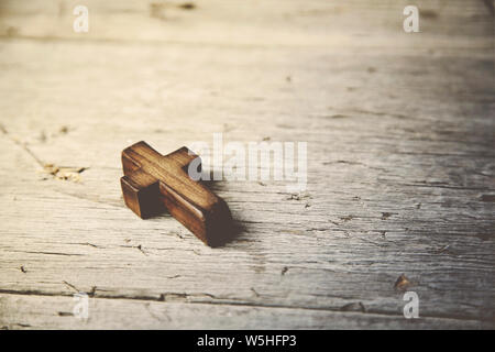 Crosses on a wooden table background - Stock Photo