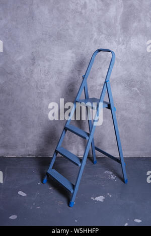 Ladder on gray background with copy space. Under construction concept background - Stock Photo