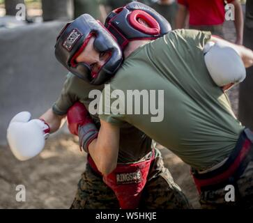 Recruits with Delta Company, 1st Recruit Training Battalion, practice the fundamentals of body sparring on Marine Corps Recruit Depot Parris Island, S.C, July 25, 2019. July 25, 2019. Body sparring is an exercise that exemplifies the fundamentals of Marine Corps Martial Arts and forces recruits to overcome physical and mental fatigue. (U.S. Marine Corps photo by Lance Cpl. Dylan Walters). () - Stock Photo