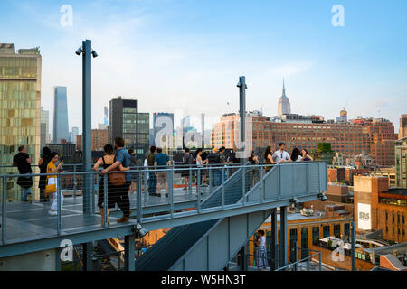 New York people, view on a summer evening of people on the Whitney Museum observation terrace looking towards Midtown Manhattan, New York City, USA.