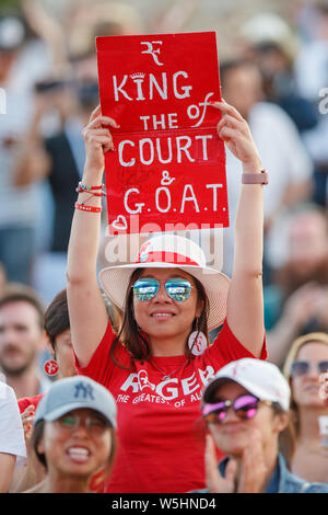 Roger Federer fans and spectators on Henman Hill Murray Mound or Aorangi Hill during The Championships at Wimbledon 2019. - Stock Photo