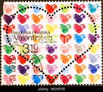 Multi colored hearts on postage stamp of Croatia - Stock Photo
