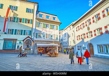 ZELL AM SEE, AUSTRIA - FEBRUARY 28, 2019: The Stadtplatz square has modest architecture, its traditional buildings are decorated with colorful shutter - Stock Photo
