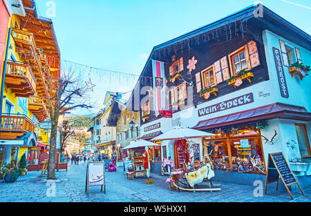 ZELL AM SEE, AUSTRIA - FEBRUARY 28, 2019: The souvenir shops and tourist stores are decorated with garlands, flags, lanterns and examples of their goo - Stock Photo