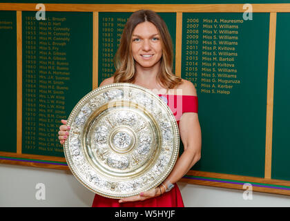 Simona Halep (ROU) with the 2019 Wimbledon Ladies' Singles Trophy at The All England Lawn Tennis Club, Wimbledon. - Stock Photo