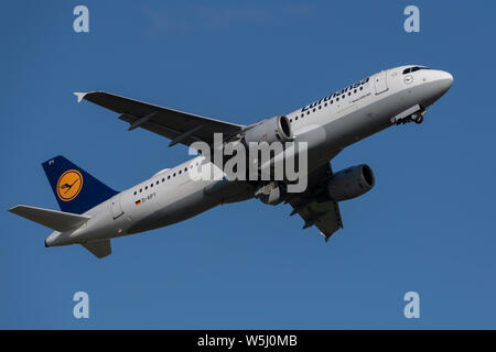 A Lufthansa Airbus A320-200 takes off from Manchester International Airport (Editorial use only) - Stock Photo