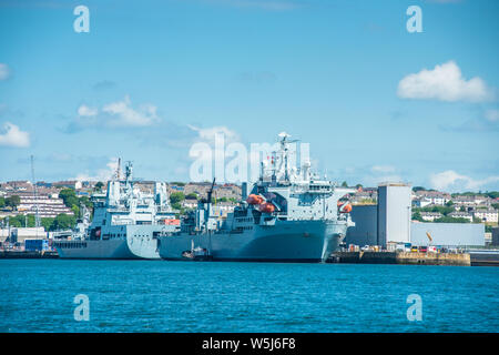 RFA Argus & RFA Tidesurge a Tide-class replenishment tanker of British Royal Fleet Auxiliary at Frigate Refit Complex HMNB Devonport, Plymouth, Devon Stock Photo