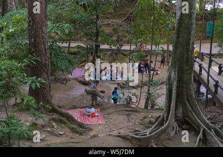 People having picnics near the Sai Yok Noi Waterfall in the Tenasserim Hills, Sai Yok District of Kanchanaburi Province, Thailand - Stock Photo