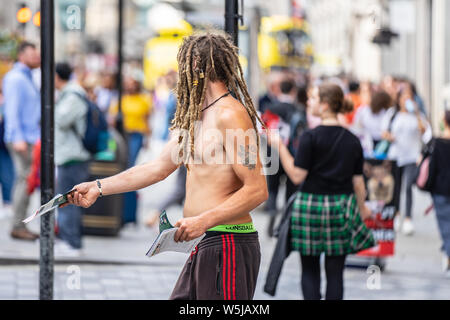 London, UK, July 14, 2019. Leaflet Distributor or Flyer Distributor. Regent Street - Stock Photo