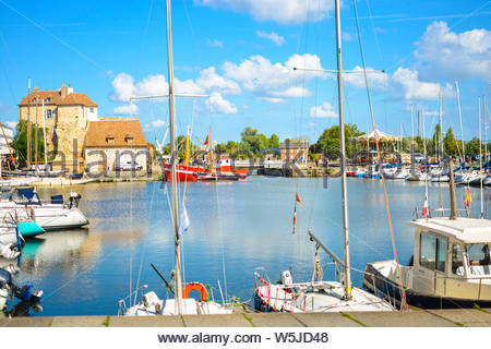 The colorful Vieux-Bassin or Old Port at Honfleur France on the coast of Normandy with sailboats, fishing boats in the water. - Stock Photo