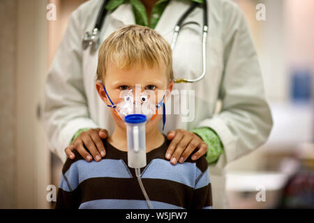 Portrait of young boy with oxygen mask. - Stock Photo