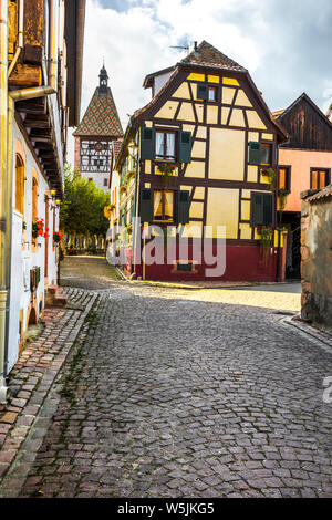 timbered houses and town gate in the village Bergheim, Alsace Wine Route, France - Stock Photo