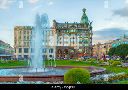 St Petersburg, Russia -October 3, 2016. Zinger House on Nevsky Prospect in the historic center of the city and fountain on the foreground. Autumn even - Stock Photo