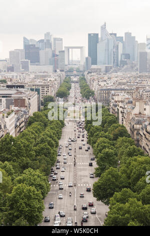 Vertical view, from Arc de Triomphe, of Champs-Élysées and La Defense business district on a cloudy day - Stock Photo