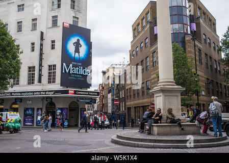 Street view of the Cambridge Theatre Royal Shakespeare Company in Earlham Street facing Seven Dials, London West End now playing Matilda the Musical - Stock Photo