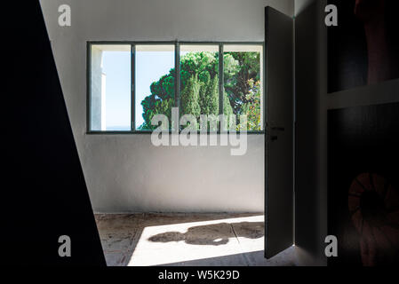 HYERES, FRANCE - JULY 28, 2019: Woman shadow and view through a window from villa Noailles, designed by the architect Mallet-Stevens, Hyeres - Stock Photo