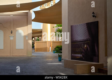DOHA, QATAR - MAY 27, 2016:  Poster of a vintage radio at the Katara Cultural Village. Photo taken at the end of a spring afternoon. - Stock Photo