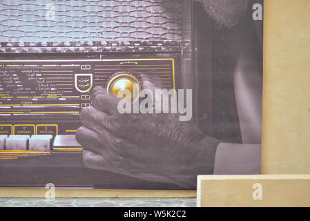 DOHA, QATAR - MAY 27, 2016:  Close-up of a poster of a vintage radio at the Katara Cultural Village. Photo taken at the end of a spring afternoon. - Stock Photo