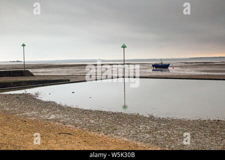 Leigh On Sea, Essex, England, boats on the sand at day's end - Stock Photo