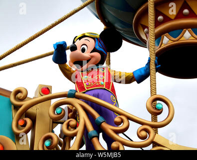 --FILE--An entertainer dressed in the costume of Minnie Mouse performs during a parade at the Hong Kong Disneyland Resort in Hong Kong, China, 19 Nove - Stock Photo